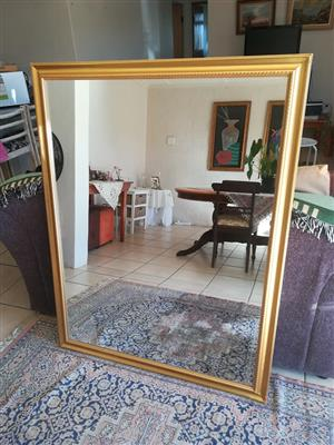 Large golden framed mirror