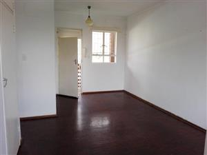 Pretoria North. Flat to let.  Spacious, neat, 2 bed flat with build-in cupboard, lounge with extra build-in cupboard, kitchen, 1 bathroom.  Large, sunny windows.