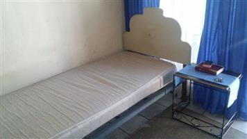 Single bed with solid wood frame