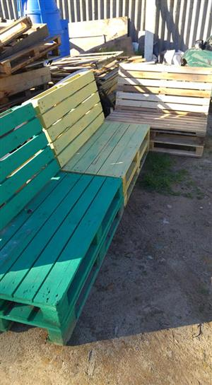 Yellow and green wooden patio benches
