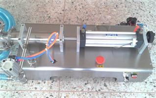 Semi automatic liquid piston filling machine