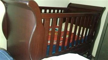 Dark wooden cot for sale