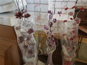 Glass flower vases with fake flowers