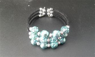 Blue plastic bead bracelet