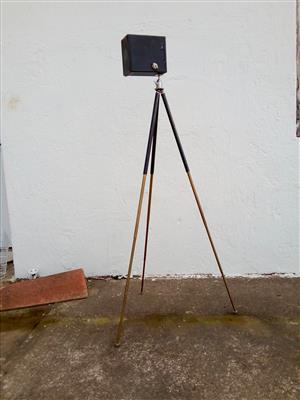 Vintage camera and brass tripod