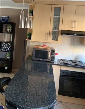 Entire kitchen cupboards including Granite Tops ,Oven, stove plates & extractor