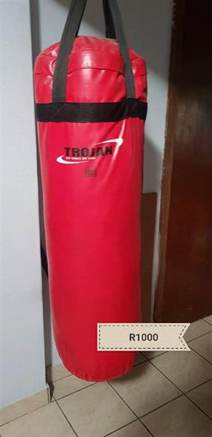 Red trojan punching bag