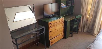 Green chest of drawers and writer desk