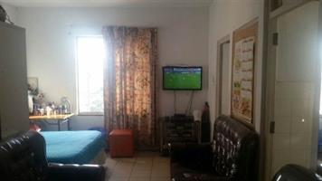 Alberton bachelor flat to rent for R3000  ABOVE SHOPS bathroom, kitchen, lounge and balcony