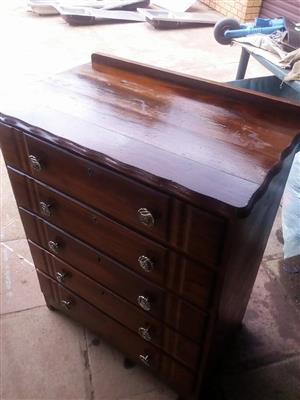 Dark wooden chest of drawers