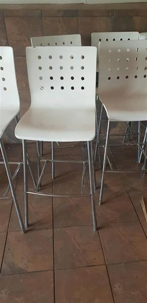 White chairs with holes