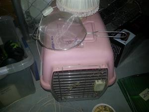 Pink pet cage with food sift