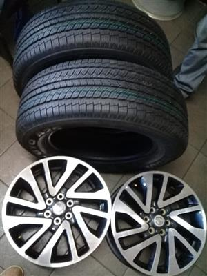 SRT of Nissan Navara original 18 inch mags with new tyres 255/60/18 set combo.