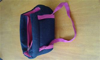 small puppy/doggy  padded carry bag thats pink and blue denim in colour