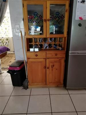 Wooden kitchen cabinet with wine bottle holder