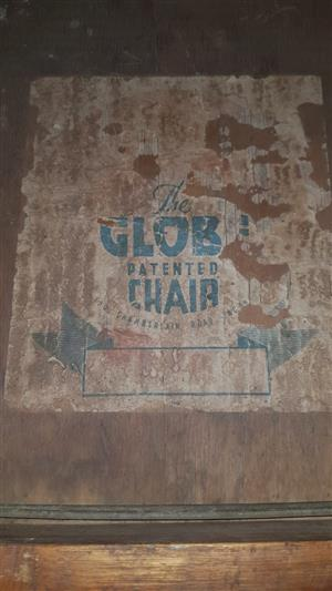 Four Globe Chairs for sale
