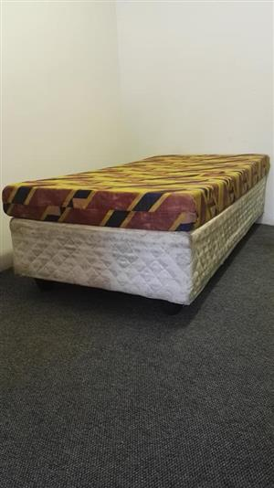 Single bed white base and colored mattress