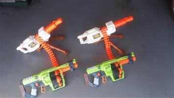 4 nerf guns.  Work with batteries.  All working.  No bullets.