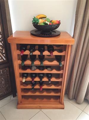 Lovely cherry coloured, pine wine rack. EXCLUDES top ornament & wine as in photo. Holds 35 bottles