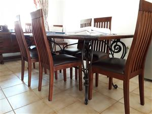 Indonesian teak dining room table and 8 chairs, 3 piece wall unit.