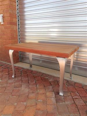 Steel foot, wooden top table for sale