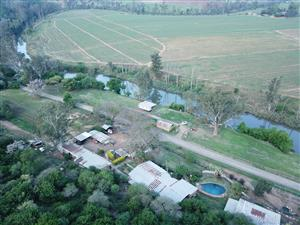 7.9 HA SMALLHOLDING ON THE BANKS OF THE UMGENI RIVER, BETWEEN PIETERMARITZBURG AND WARTBURG – PRIVATE SALE! Includes a running camp / picnic grounds