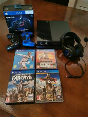 Playstation 4, 500Gb with 2 PS4 controllers,1 Nacon PS4 controller,1 Turtlebeach PX22 headset and 4 PS4 games.