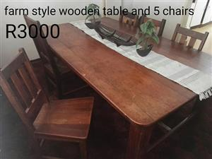 For sale farm style wooden table and 5 chairs