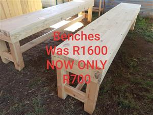 Long light wooden benches