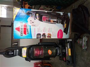 Bissell upright vacuum cleaner in new condition.