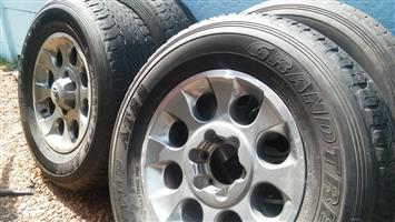 """Rims and tyres from Toyota Land Cruiser: four 17"""", six-stud Mag rims and five tyres in good condition for similar vehicles"""