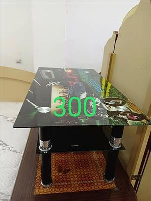 Glass coffee table with shelf.