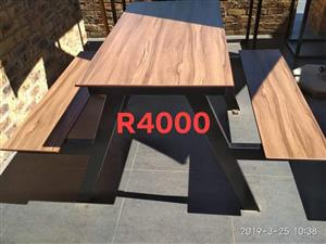 Outdoor patio table with benches