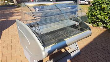 Display warmer, curved glass