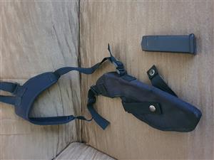 Glock 23 magazine and holster