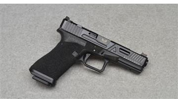 Agency Arms Glock G22 with both a 9mm and .40 S&W barrel as well as magazines for both calibers.