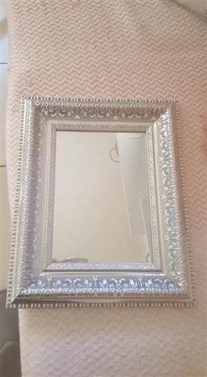Smaller silver framed mirror