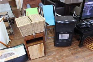 Gas heater,green and blue chairs,picnic basket and wooden pedestal