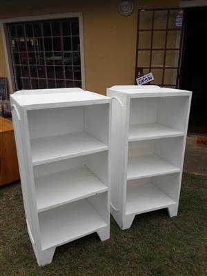 Narrow, white bookcases