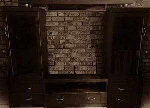 Wall unit - 4 piece. Wooden. Good condition.