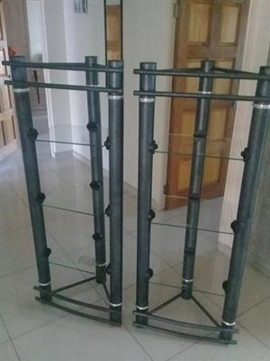 two stands with glass shelves