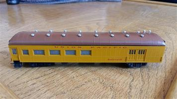 Brown and yellow union pacific model train