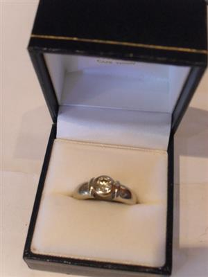 9ct White Gold Solitaire Ring with approximately .30ct Diamond.