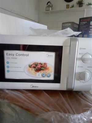 White Midea microwave for sale