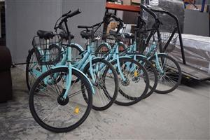 Blue road bikes with baskets for sale