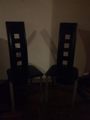 2 Black dining chairs for sale