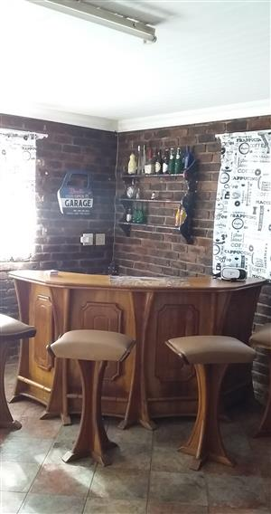 Bar with 4 bar stools and light fittings