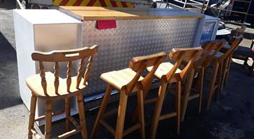 Bar with wooden chairs for sale