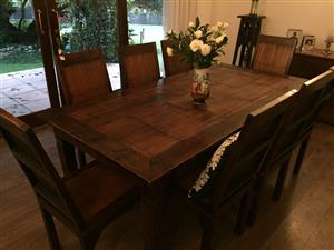 Dining room table and Indonesion stands, glass table on plinths...
