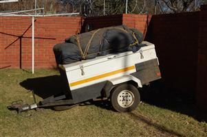 Complete campimjg trailer with OZram 3 room tent and everything that you may need.  Pach clothes and food hitch and go.